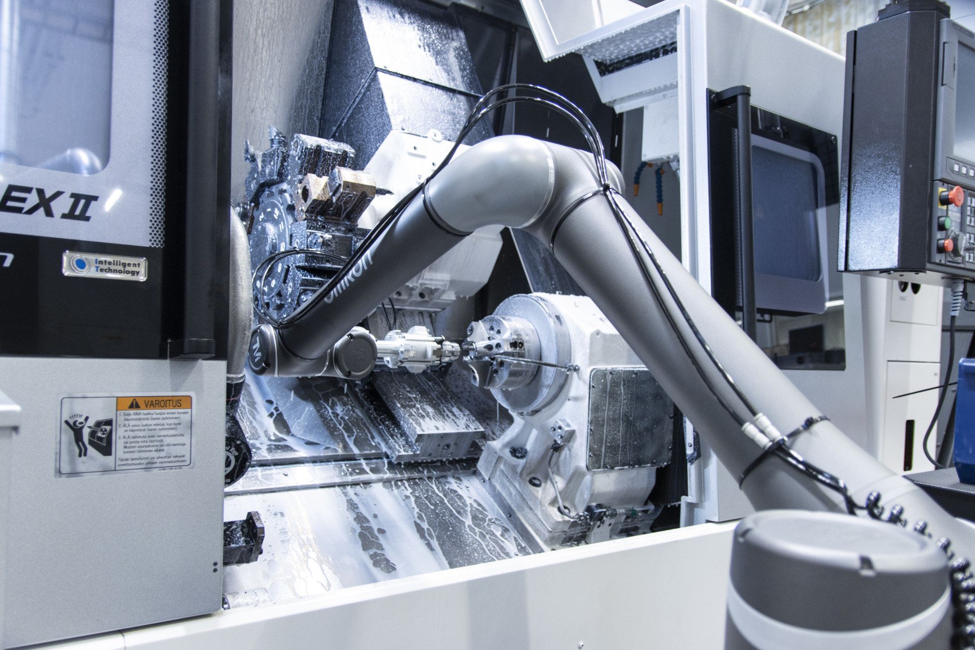 A co-bot removing an item from a machining centre