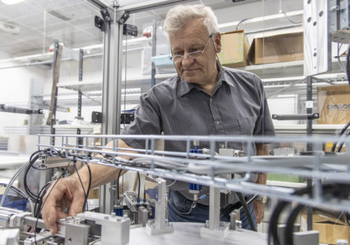 An older man takes a look at an automation unit