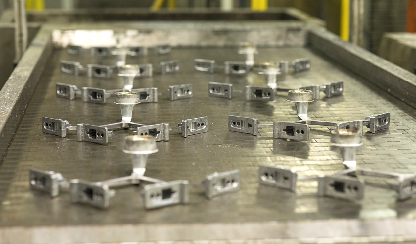 Die casted components on a production line