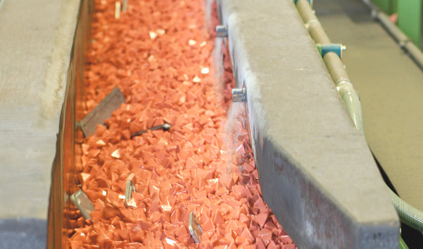 Vibration grinding line with abrasive stones