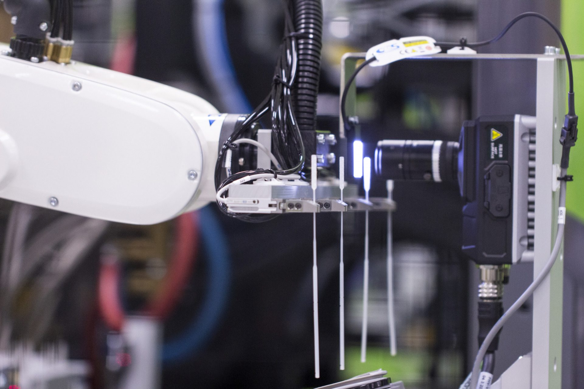 A medical device being inspected by machine vision
