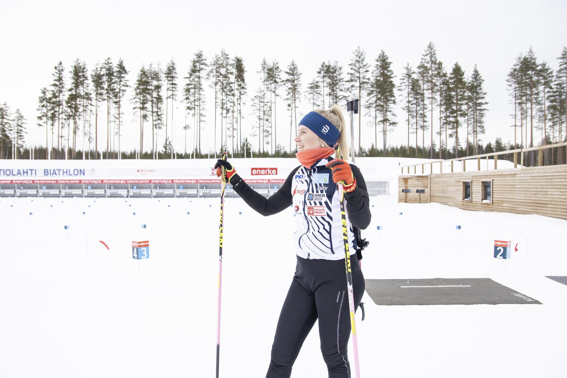 Biathlon athlete smiling at the sun